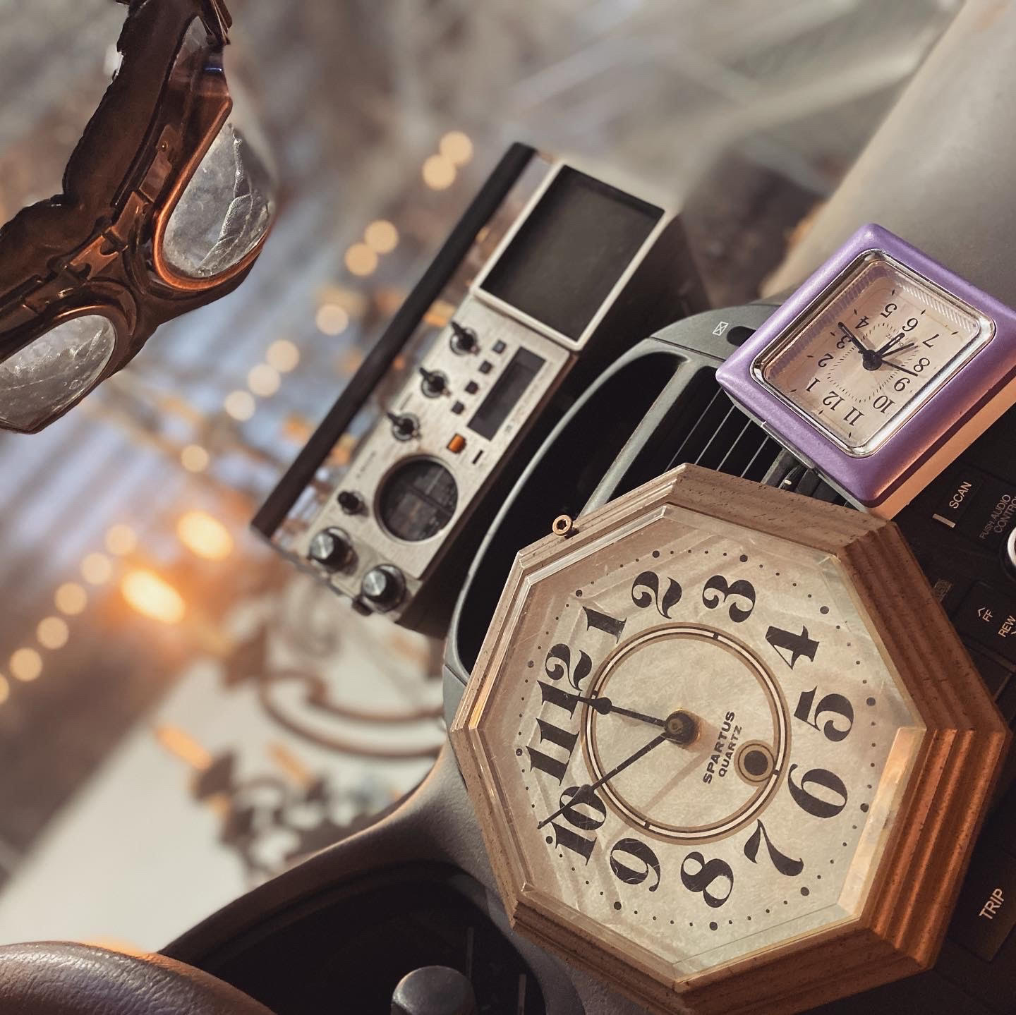 A photo of a collection of time pieces with an old CB radio.