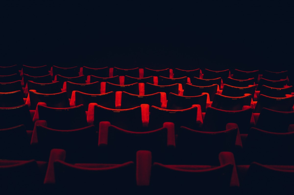 Dark theater with red movie seats