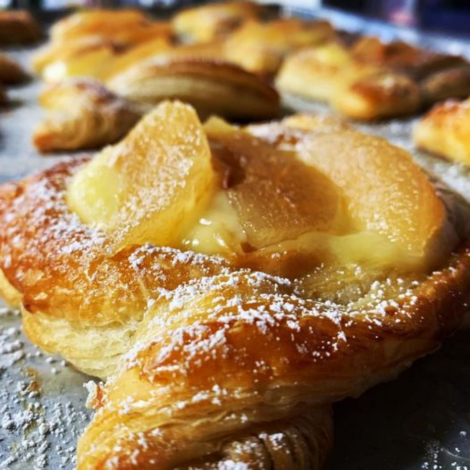 A close up photo of golden brown pastries.