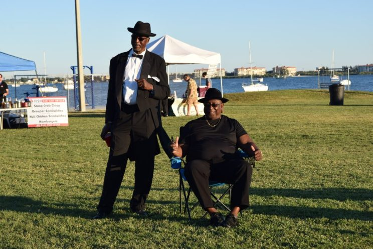 """Brady Johnson of St. Petersburg, left, and his friend Ronald Stout of Clearwater enjoy the sounds of the Tomkats Jazz Orchestra. """"This should matriculate into an annual jazz festival and just get bigger and better,"""" Stout said."""
