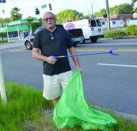 "Gulfport Councilman Fridovich received the ""Golden Picker Award"" for the most unusual piece of trash: a broken sign."
