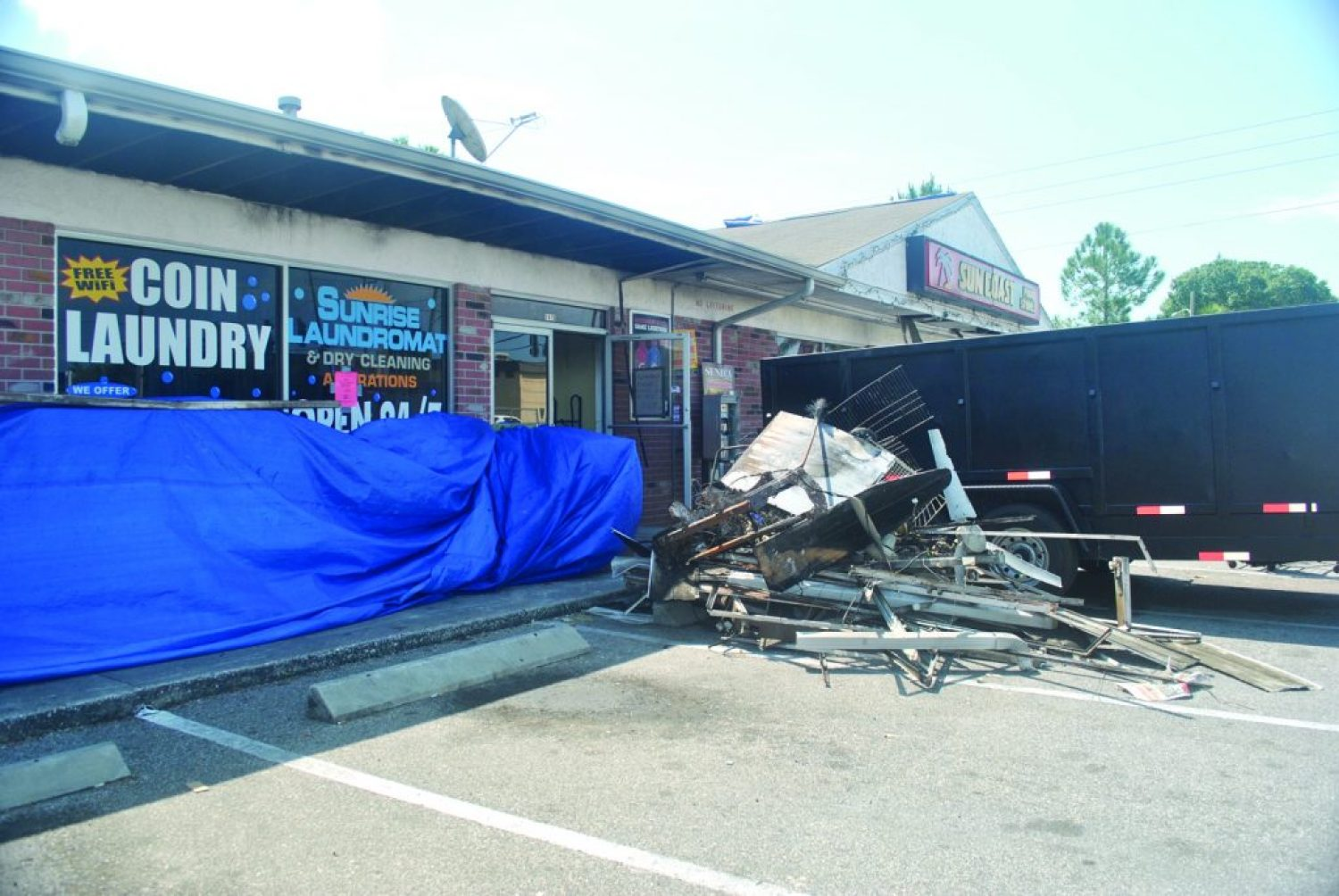 Four businesses were damaged by a recent fire; residents and local organizations are picking up the slack to help.