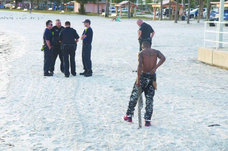 joe-louis-bradford-with-chain-and-police-on-gulfport-beach_photo-by-eagle-finegan