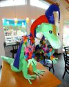 Artist John Ricci's 2015 entry is a three dimensional New Orleans Mardi Gras-inspired gecko made of papier-maché and will be on display at Yummy's on Beach Boulevard in the Gulfport Waterfront District until the Gecko Ball charity auction.