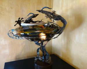 Owen Pach was an established woodworking artist at the age of 30 in Ybor City when he discovered his passion for glass art. His work is included in numerous private and public art collections. He originated the gecko art auction event in 2010.His 2015 Gecko is on display at Pia's Trattoria.