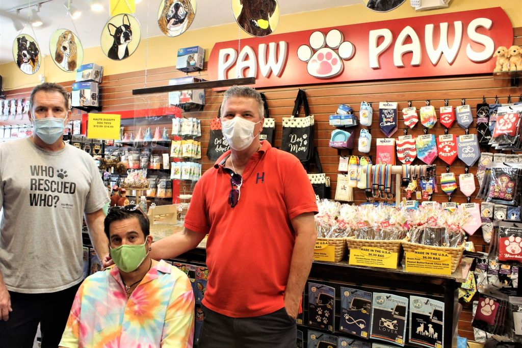 Owners/operators of Paw Paws in store wearing masks