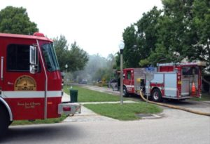 Local fire trucks respond to a house fire near Tomlinson Park, one of two in Gulfport over the holiday weekend. No one was injured in either event. Photo by Zachary Knight