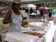 Brenda Boykins of Gulfport serves up some pulled pork from Smokin' J's BBQ for a waiting customer.