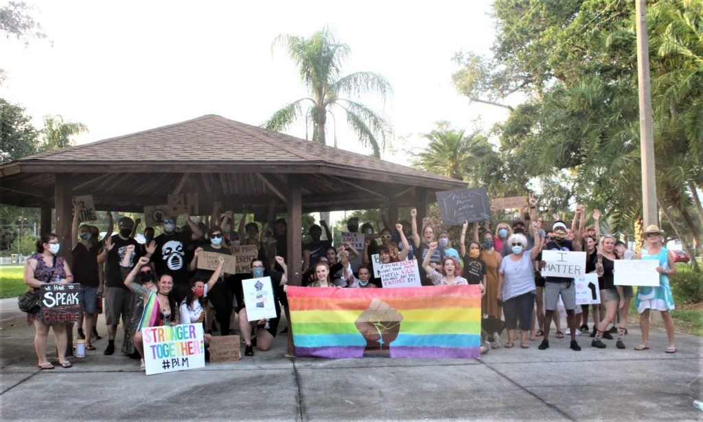 A full group shot from the Gulfport Supports Black Lives Matter march on Friday, 12 June with rainbow banner and protest signs.