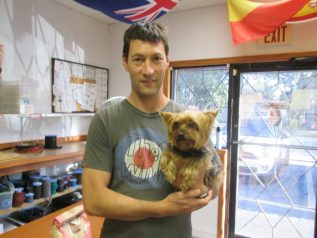 Graham Dykes holds his Yorkie, Nelson, after almost losing him to dognappers Monday.