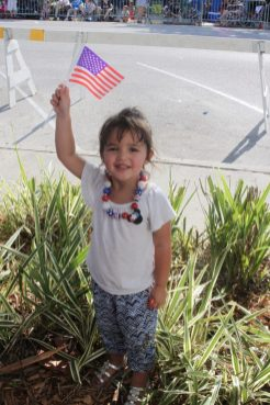 Grayson Duff waves her flag to celebrate the Fourth.