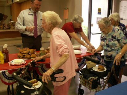 Senior Center staff and volunteers serve several dozen people who attended the barbecue at the Gulfport Multipurpose Senior Center on Wednesday, July 1.