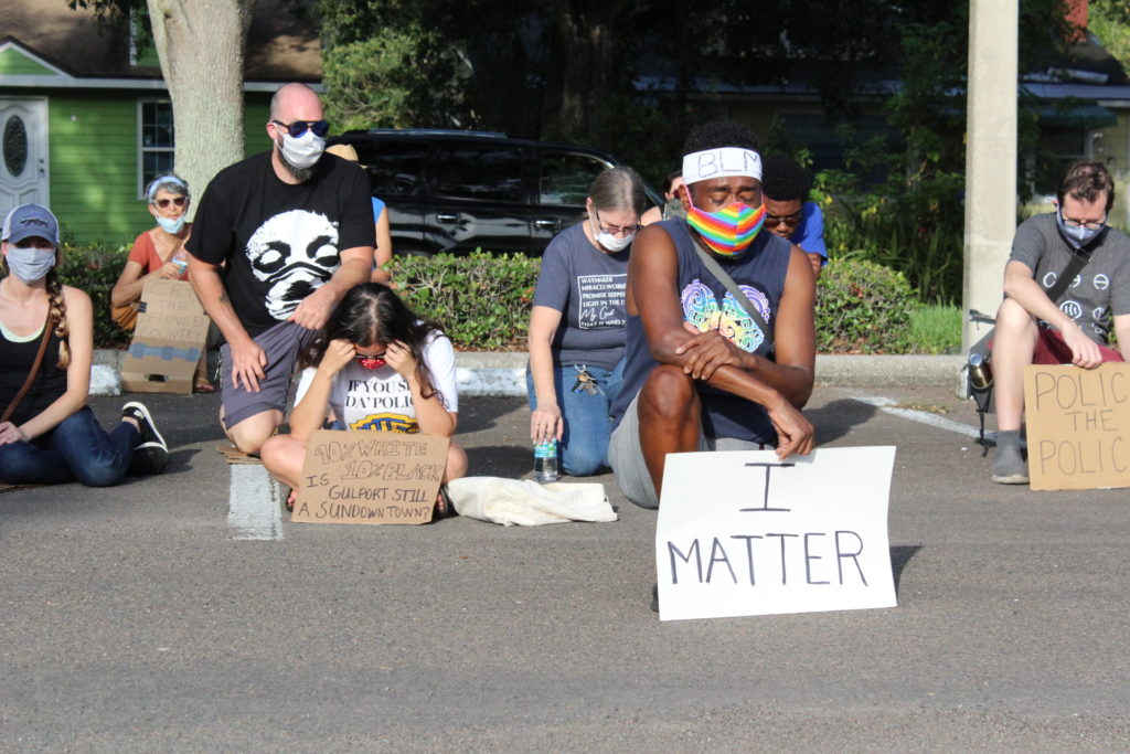 For 8 minutes and 46 seconds protestors remained silent in front of the Gulfport Police Department Monday evening, June 8.
