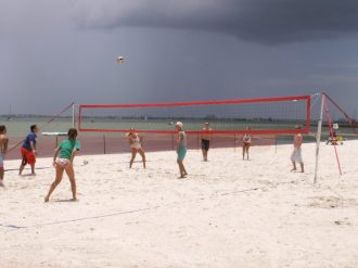 Beach Bums play at the temporary volleyball court they set up on the beach next to the Gulfport Casino for Saturday's tournament. The other four regular courts were also full.