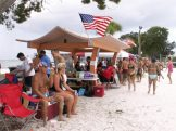 Members of the Tampa Bay Beach Bums hang out at Gulfport's municipal beach Saturday while awaiting their turn to play.