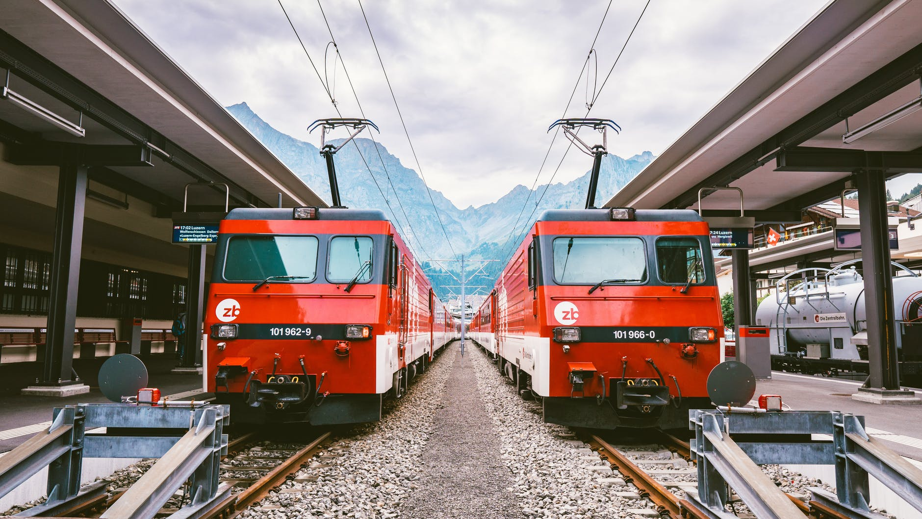 photo of two red trains