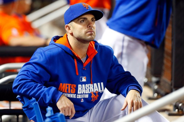 David Wright's shoulder may keep him from being on the Mets' Opening Day roster, (Jim McIssac/Getty Images)
