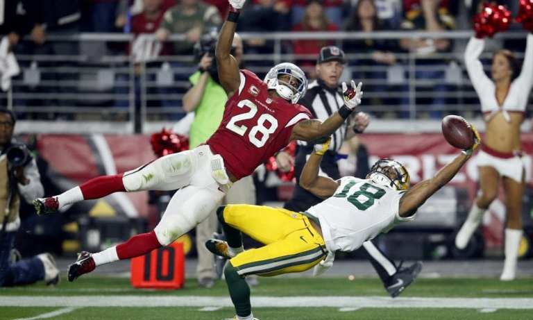 Green Bay Packers wide receiver Randall Cobb (18) makes a one-handed catch but has it called back on a penalty as Arizona Cardinals cornerback Justin Bethel (28) defends during the first half of an NFL divisional playoff football game, Saturday, Jan. 16, 2016, in Glendale, Ariz. (AP Photo/Rick Scuteri)  ORG XMIT: AZMY