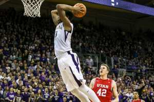 Washington forward Marquese Chriss breaks away for a dunk as Utah forward Jakob Poeltl watches in the second half as the University of Washington Huskies take on the Utah Utes at Alaska Airlines Arena in Seattle Sunday January 24, 2016. (Bettina Hansen / The Seattle Times)