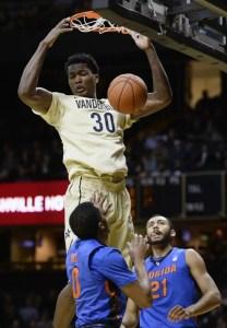 Vanderbilt center Damian Jones (30) dunks the ball over Florida guard Kasey Hill (0) and forward Jon Horford (21) in the first half of an NCAA college basketball game Tuesday, Feb. 3, 2014, in Nashville, Tenn. (AP Photo/Mark Zaleski)