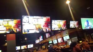 Customers enjoying food and eSports at Buffalo Wild Wings.