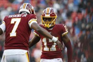 Haskins Jr. and McLaurin dap after the Redskins beat the Lions.