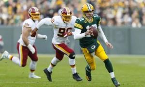 Aaron Rodgers scrambles past Redskins' defense in Week 14 win.