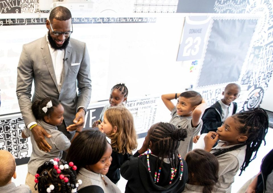 Lebron James attends the official opening of the Promise School