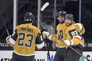 Vegas Golden Knights players Shea Theodore, Alex Tuch and Alec Martinez