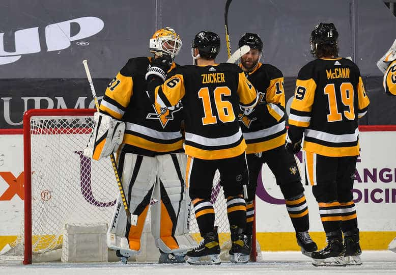 Maxime Lagace celebrating with Penguins after his first shutout