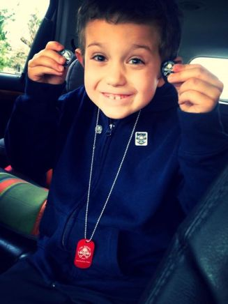 """From Facebook: Totally made his day!!!! Saved his quarters for months to buy this dog tag. He said with the guitar picks that """"mr coffee"""" gave him he could be a rockstar!! Thanks for making him smile"""