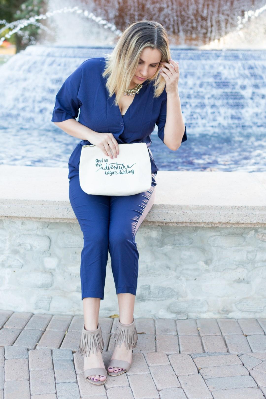 blue jumpsuit, statement necklace, fringe sandal wedges