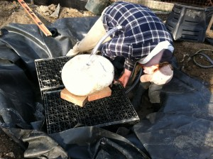 Placing the tubing through the drilled hole of the fountain
