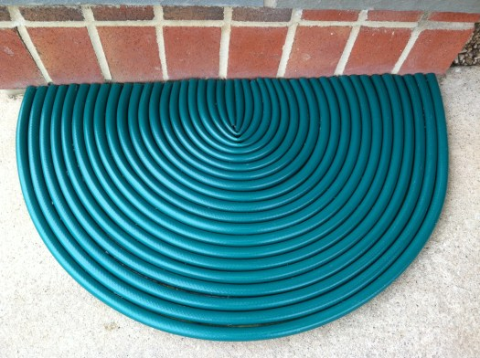 Floor mat made out of cut hoses