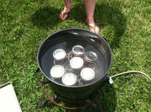 In the canner on a propane portable burner