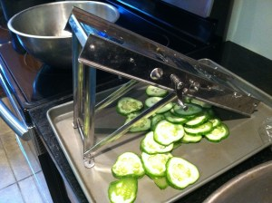 A mandolin slices the cucumbers in a few seconds