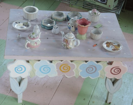 In the children's cottage is this charming tea party set up