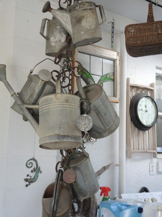 Old watering cans used as decorations
