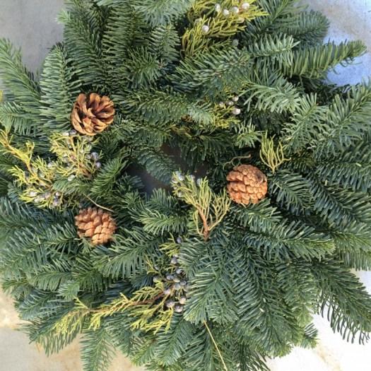 Use a pre-made wreath as a base