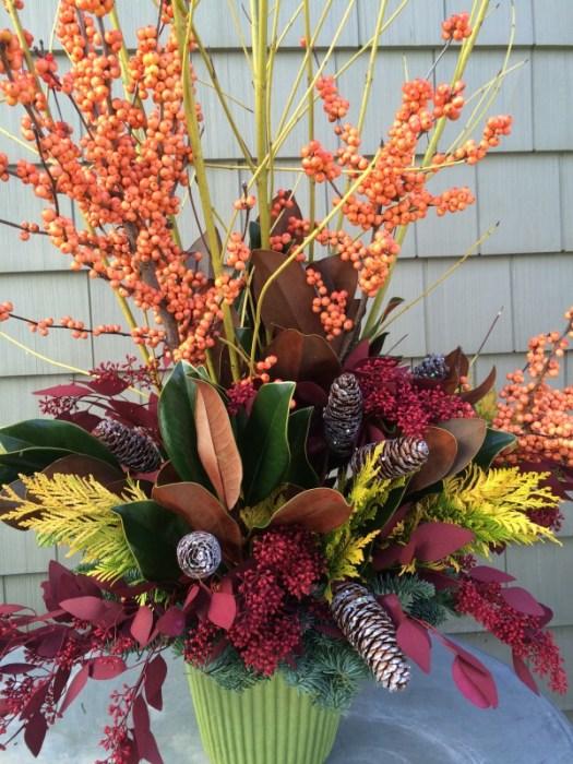 Add peach colored winterberry and some sparkly pine cones