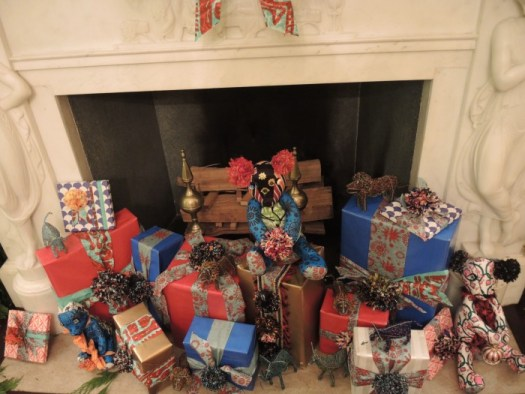 Heaps of wrapped packages decorate the hearth