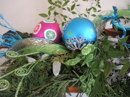 Wire your balls on the garland, clustering the larger ones in the center