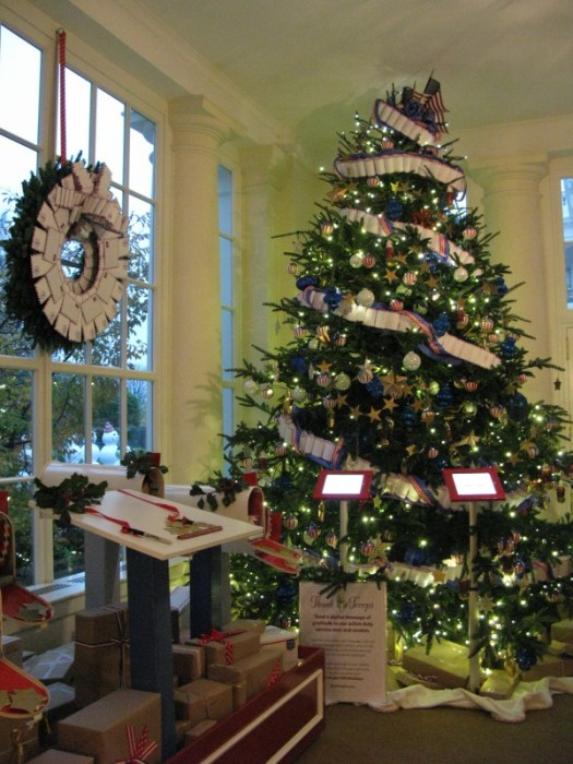 Military tree decorated with air mail letters, stuffed with card stock, folded, and stapled to make garlands and wreaths