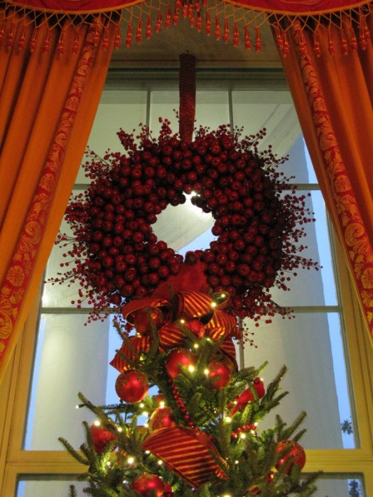 Cranberry wreaths in the windows and cardinals on top of the trees in the Red Room