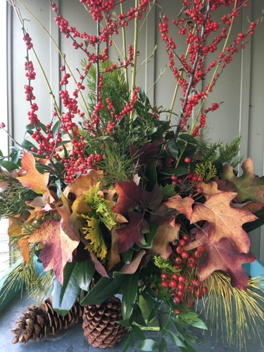 An outdoor arrangement on a covered porch or deck can use beautiful fall foliage and evergreens from the garden