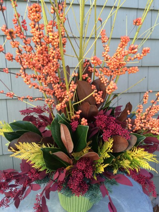 Peach winterberry, magnolia, gold arborvitae, yellow twig dogwood, and red dyed eucalyptus