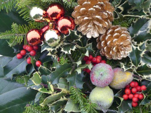 Closeup of cones, balls, and sugared fruit