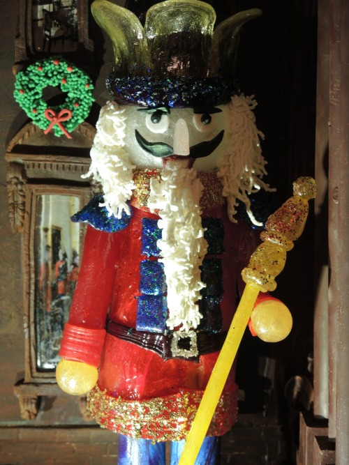 Detail of the gum paste nutcracker on gingerbread house