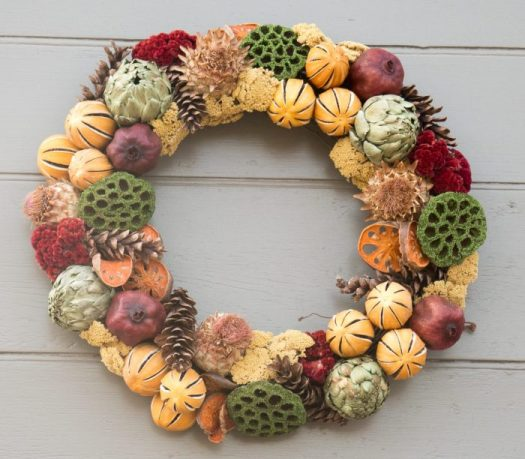 Green lotus pods make this wreath stand out