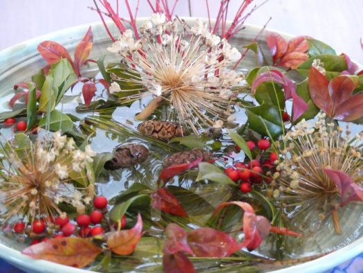 A winter arrangement with nandina and dried alliums